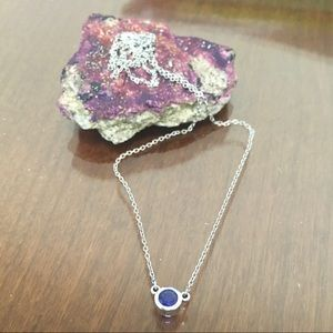 Beautiful bezel-set sapphire in 14k white gold